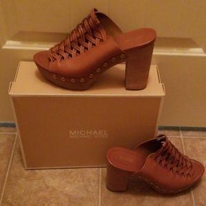 BNWT MK Westley leather mule ACORN in color.